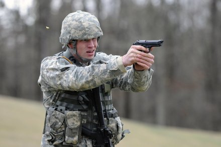 U.S. Army Spc. Caleb Roberts fires an M9 Beretta pistol during the Mississippi National Guard's Best Warrior Competition at Camp McCain, Miss., Feb. 20, 2013. Roberts, with Detachment 1 of the 3656th Maintenance Company, was named Soldier of the Year.