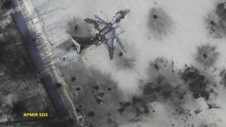 Still image taken from handout aerial footage shot by drone shows outline o airplane in the snow at the Sergey Prokofiev International Airport damaged by shelling during fighting between pro-Russian separatists and Ukrainian government forces, in Donetsk